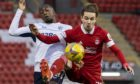 Aberdeen's Scott Wright battles with Rangers' Glen Kamara on Sunday.