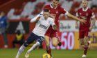 Rangers' Ryan Kent (left) tussles with Aberdeen's Tommie Hoban