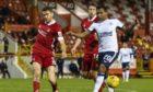 Aberdeen defender Tommie Hoban battles with Rangers' Alfredo Morelos.