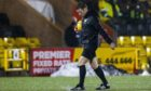 Referee Steven McLean carrying out a pitch inspection last night.