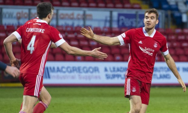 Tommie Hoban (right) celebrates after scoring for Aberdeen.