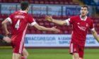 Aberdeen's Tommie Hoban (right) celebrates after his header is turned into his own net by Alex Iacovitti.