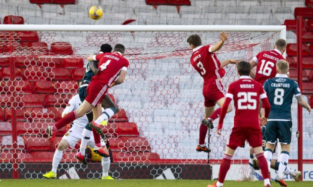 Aberdeen's Tommie Hoban (centre) makes it 1-0 against Motherwell.