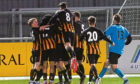 Gavin Elphinstone celebrating with team-mates after scoring to make it 3-1. Picture by Kenny Elrick