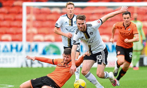 Bristol City's Marley Watkins, right, while on loan at Aberdeen.