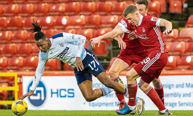 Lewis Ferguson, right, in action for Aberdeen against Rangers on Sunday.