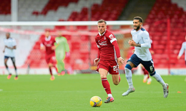 Aberdeen forward Bruce Anderson (21) sprints ahead of Rangers defender Connor Goldson (6)  during the Ladbrokes Scottish Premiership match in August.