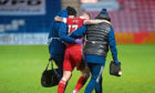 Aberdeen's Jonny Hayes going off injured in the 4-1 loss at Ross County.