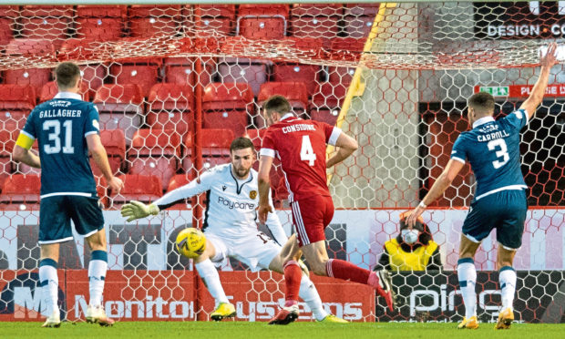 Andy Considine fires Aberdeen into a 2-0 lead against Motherwell.