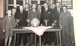 Bill Maitland began playing golf after his mother Jessie Maitland paid his subscription as a junior member at Fraserburgh in April 1945. He is pictured, left, with his first trophy - the Russell Thom Cup - four years later.