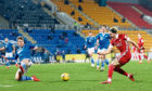 Ryan Hedges, right, tries to get a shot off against St Johnstone.