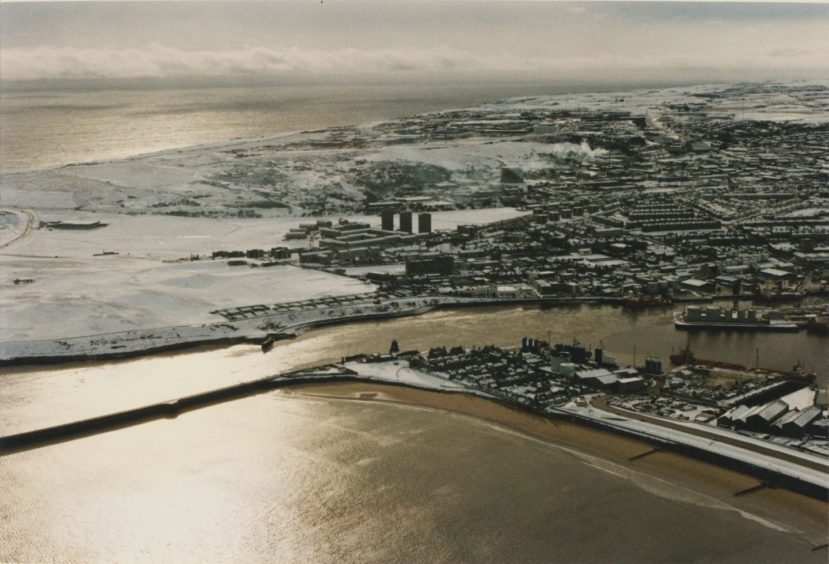 1993: Looking south over Aberdeen covered in snow with Footdee in the foreground.