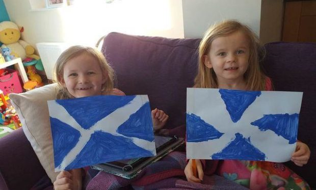 Amy, 6, and Cara, 4, with their Scotland flags.