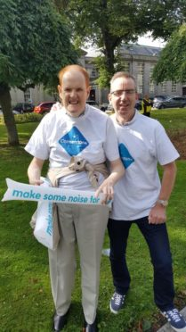 One of the service users at Cornerstone with his support worker at a fundraising event.