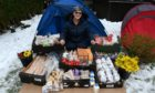 Helen Aitken at the help yourself station in Kemnay.  Picture by Kenny Elrick.