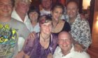 Liza, front centre and John, front right with family in South Africa.