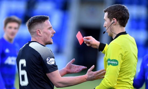Simon Ferry is red carded by referee Peter Stuart at the Balmoral Stadium