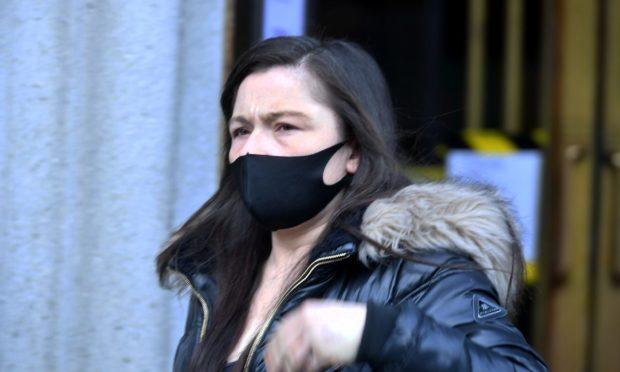 Ashleigh MacDonald, known as McAuley, leaving court.