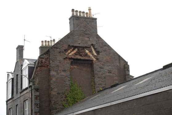 The damage wall at Hollybank Place