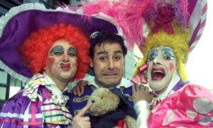 Andy Gray as Buttons in Cinderella at HMT in 1996, with Ugly Sisters Richard Pocock   and William Elliot.
