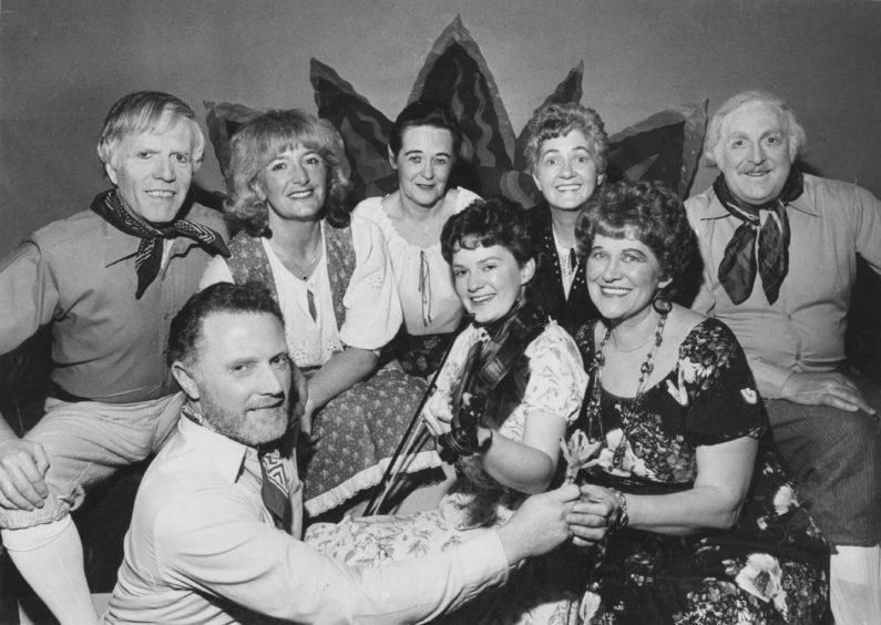 1985: Performers from The Best of Both Worlds, which is being staged at Aberdeen College of Commerce by Pro Arte this week, take the stage for a souvenir picture. Serenading the Gipsy Princess (Margaret Robertson, Aberdeen) and the Gipsy Baron (Ian Middler, Aberdeen) is Tricia Shand, Buckle, while looking on (left to right) are Norman McDonald, Frances Wregg, Sheena Hunter, Betty Davie and Eric Coutts, all Aberdeen.