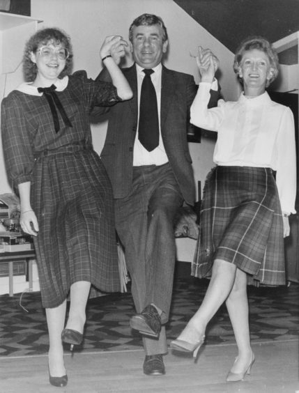 1985: Special guest Jimmy Spankie was first on the dance floor with not one but two of the committee, (left) Linda Smith (Chairwoman) and (right) Betty Scorgie the social convener at the Pro Arte St Andrews evening.