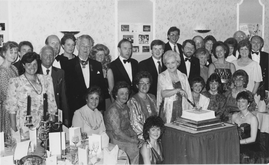 1988: Members of the Light Opera Company Pro Arte cut their Birthday cake to celebrate 20 years of Musical Entertainment. Past and present members joined in a dinner and dance in the Amatola Hotel, Aberdeen on Saturday evening. The company has performed many well known shows over the years, including Merry Widow, Waltzes from Vienna and his year's showt he New Moon pictured cutting the cake is Musical Director Mrs Kathleen Stuart.
