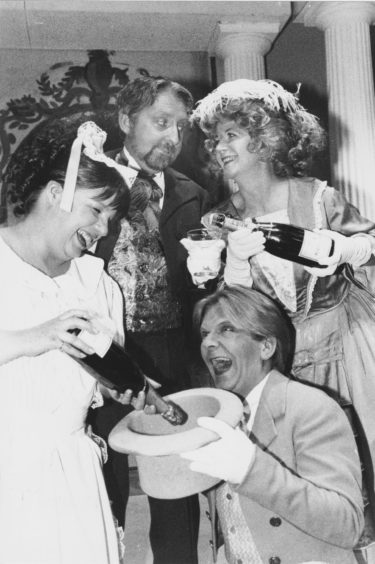 1993: The champagne is flowing as Pro Arte members (clockwise from left) Gill Johnston, Des Chrystal, Marianne Inkson and Edi Hutchison prepare for their production of La Vie Parisienne, which is at the Arts Centre this evening with performances nightly until Saturday.