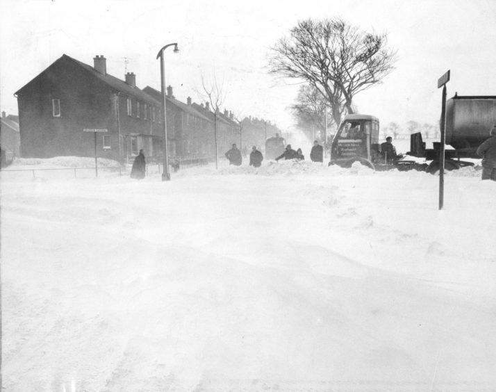 1969. This tanker, which attempted to negotiate the Howe of Bucksburn road into Northfield, had to be dug out by County Council workmen.