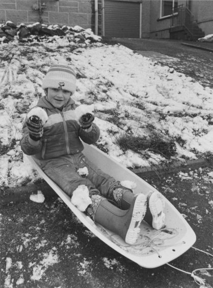 1982: The first fall of snow of the winter certainly pleased four-year-old Michael Millar, of 60 Kinmundy Drive, Westhill, Aberdeen, who enjoyed playing with his sledge today.