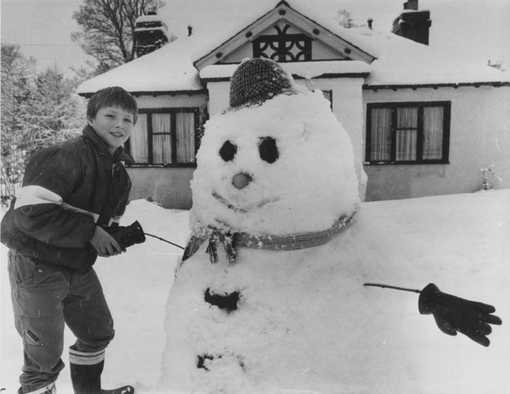 1985: Two faces of winter in the North-east yesterday captured by photographer Graham Robertson. For youngster Richard Merchant (above), the snow could only be put to good use and what a fine fellow of a snowman he has built. Richard (10), 47 Station Road, Banchory, shakes on it with his snowman.