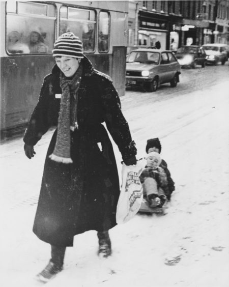 1985: The fastest way to the sales in Aberdeen this morning way by sledge… Mrs Sue Lessels, of Whitehall Terrace, and her children, Tom (3) and Ellie (6) have the snail's pace traffic beaten as they make their way down Union Street.