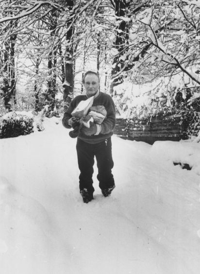 1987: Not quite so hard labour but still a chore Mr Ronald Wilson, the Toll House, Banchory, is almost up to his knees in the snow as he fetches logs from his woodshed to keep his home fires burning. Perhaps he could borrow some snow shoes from friendly Eskimos