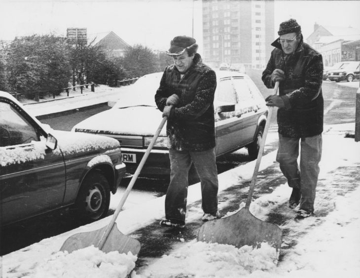 1987: Street orderlies George Douglas (left) and Ronald Walker clear the snow from the Greenfern Road, Mastrick, pavements this morning.