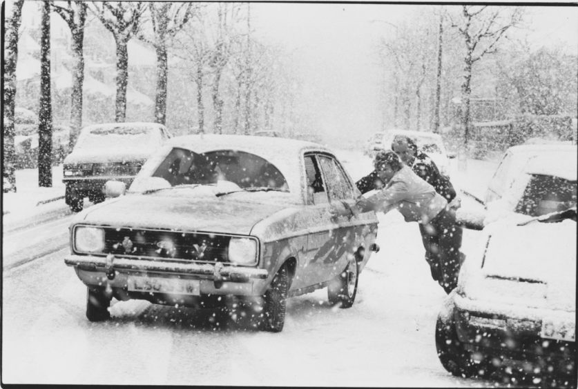 1988: Drivers who slithered to a halt going up King's Gate, Aberdeen, in the snow this morning help to push each other's car out of trouble.