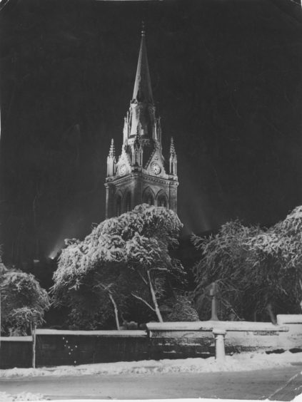 1961: The majestic spire of the West Church of St Nicholas, framed in this wintry setting, from which the midnight chimes have rung out in the past will, this year, be silent… they are frozen! But the New Year will still be greeted by the big bell which will be rung for two minutes at midnight, and then the carillon will play.