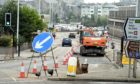 Aberdeen City Council had been placed on an improvement plan over its roadworks programme.