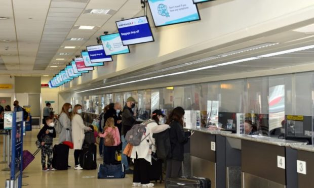 Travellers at Aberdeen International Airport in July 2020, the first day flights to Alicante, Spain, resumed following the initial coronavirus lockdown.