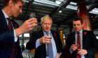 Boris Johnson and Scottish Conservatives leader Douglas Ross, left, enjoy a dram.