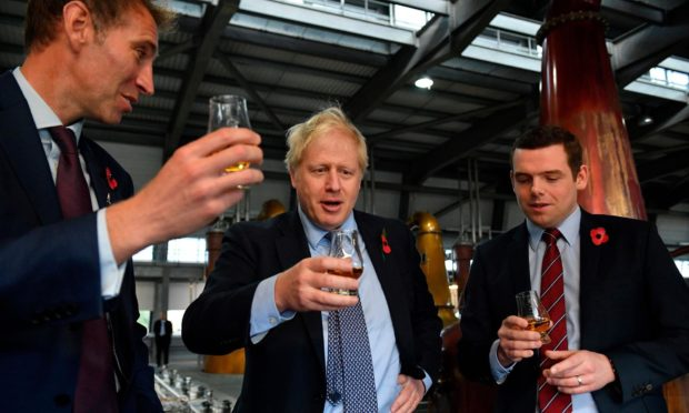Boris Johnson and Scottish Conservatives leader Douglas Ross, left, enjoy a dram.