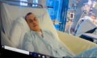 """Asbjorn Morell awoke from an induced coma after 10 days. His family skyped twice daily. Once he was reported to be """"flirting with the nurses"""", the family knew he was okay."""