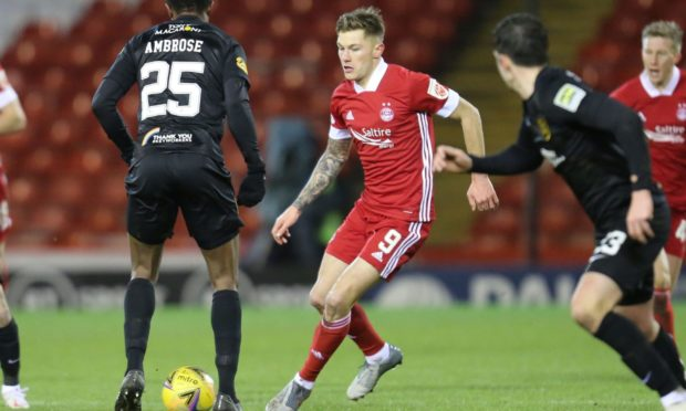 Callum Hendry in action on his Aberdeen debut against Livingston.
