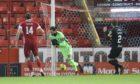 Joe Lewis lets Julien Serrano's cross slip through his hands for the opening goal