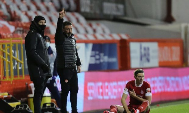 Aberdeen midfielder Ryan Hedges went off injured against Livingston.