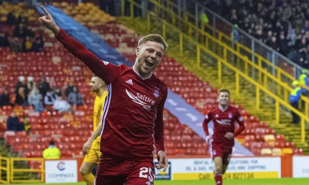 Aberdeen's Bruce Anderson celebrates after scoring against Livingston.