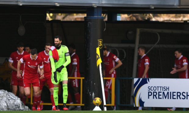 The Aberdeen players take to the pitch during the Premiership stalemate with Livingston on Saturday.