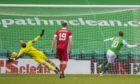 Hibernian's Martin Boyle makes it 1-0 from the penalty spot  against Aberdeen.