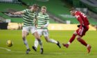 Aberdeen's Florian Kamberi has a first half shot on goal against Celtic.