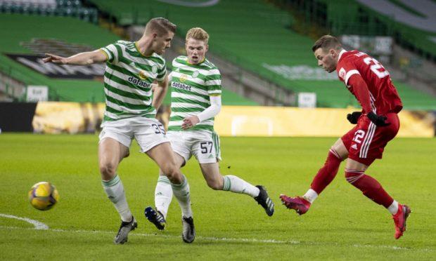 Aberdeen striker Florian Kamberi, right, has a shot against Celtic.