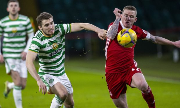 Jonjoe Kenny of Celtic and Jonny Hayes in action